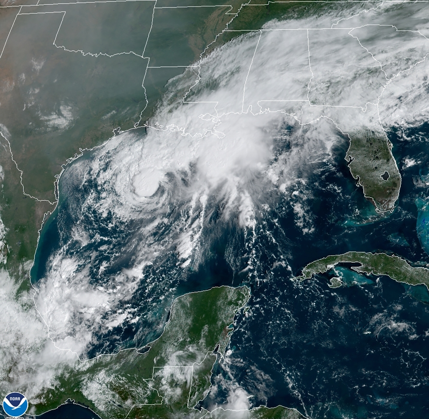 This GOES-16 GeoColor satellite image taken Saturday, Sept. 19, 2020, and provided by NOAA, shows Tropical Storm Beta, center,  in the Gulf of Mexico.  A hurricane watch is in effect Saturday for coastal Texas as Tropical Storm Beta gains strength.  A storm surge watch and a tropical storm watch are also in effect for the area during an exceptionally busy Atlantic hurricane season.  Photo: AP