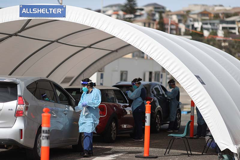 Medical personnel are seen at the Bondi Beach coronavirus disease (COVID-19) drive-through testing centre, as the state of New South Wales continues to report relatively low numbers for new daily cases, in Sydney, Australia, September 2, 2020.  REUTERS/Loren Elliott