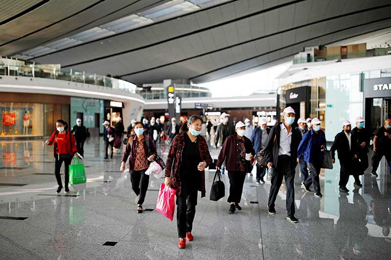 Travellers wearing face masks walk at Beijing Daxing International Airport following the global outbreak of coronavirus disease (COVID-19), in Beijing, China, on September 19, 2020. Photo: Reuters