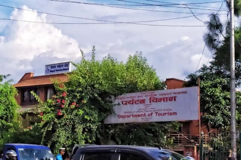 Vehicles are seen passing by the road in front of the Department of Tourism in Bhrikutimandap, Kathmandu, in August, 2019. Photo courtesy: Sanjay Nepal