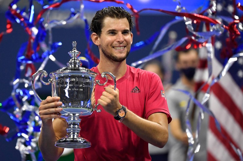 Dominic Thiem of Austria celebrates with the championship trophy after his match against Alexander Zverev of Germany (not pictured) in the men's singles final match on day fourteen of the 2020 US Open tennis tournament at USTA Billie Jean King National Tennis Center, in Flushing Meadows, New York, USA, on Sep 13 2020. Mandatory Credit: Danielle Parhizkaran-USA TODAY Sports via Reuters