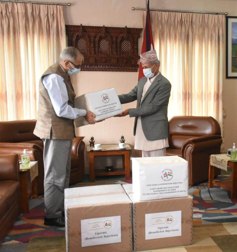 Indian Ambassador to Nepal Vinay M Kwatra handing over 2,000 vials of Remdesivir to Minister of Foreign Affairs Pradeep Kumar Gyawali on behalf of the government of India, in Kathmandu, on Tuesday, September 15, 2020. Photo Courtesy: IndiainNepal/twitter