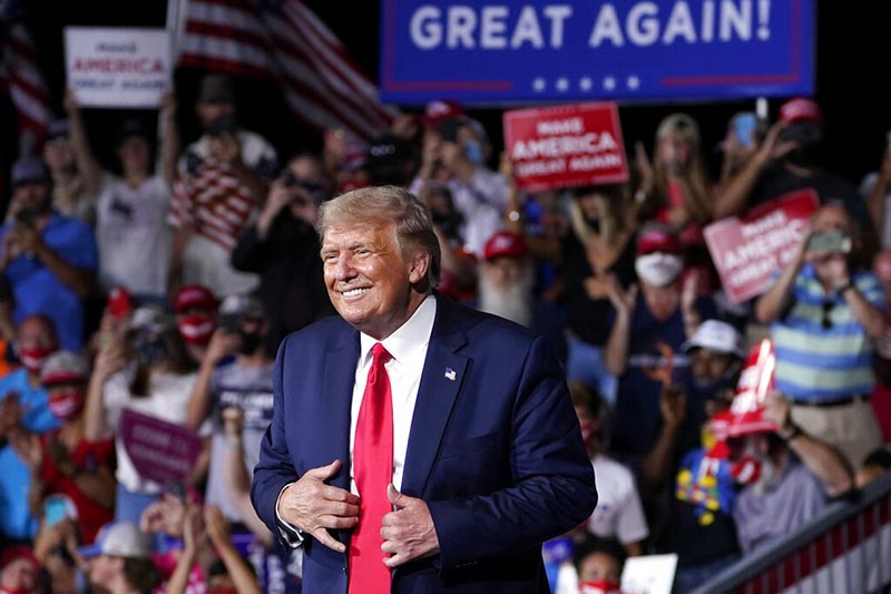 President Donald Trump stands on stage after speaking at a campaign rally at Smith Reynolds Airport, on Tuesday, September 8, 2020, in Winston-Salem, North Carolina. Photo: AP
