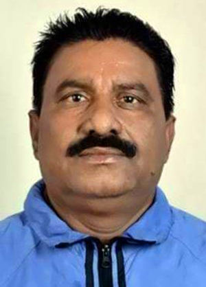 This undated image shows former athletics coach Ramesh Prasad Sah.