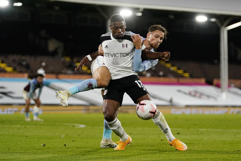 Fulham's Ivan Cavaleiro in action with Aston Villa's Matty Cash during their Premier League n match at Craven Cottage, in London, Britain, on September 28, 2020. Photo: Pool via Reuters
