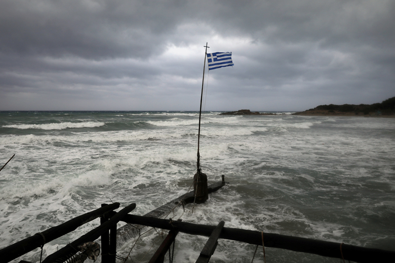 A Greek flag flatters in a beach near the town of Kyllini, as rare storm, known as a Medicane (Mediterranean hurricane), hit western Greece, September 18, 2020. Photo: Reuters