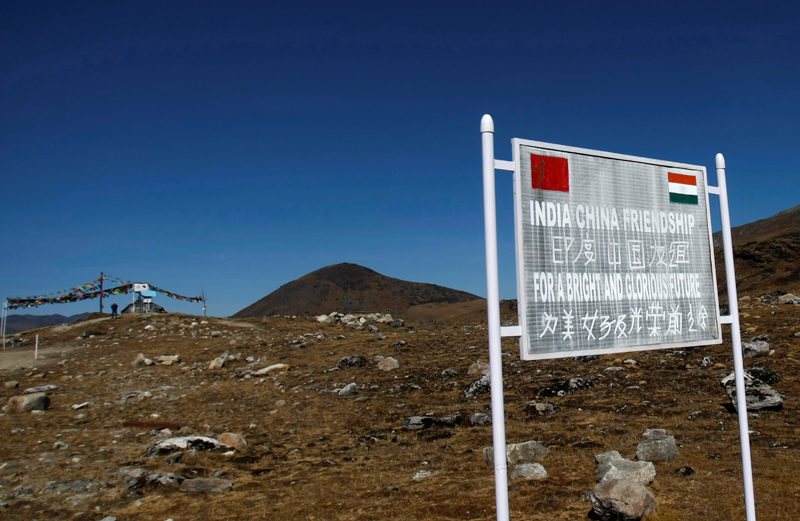FILE PHOTO: A signboard is seen from the Indian side of the Indo-China border at Bumla, in the northeastern Indian state of Arunachal Pradesh, November 11, 2009. Photo: Reuters/File