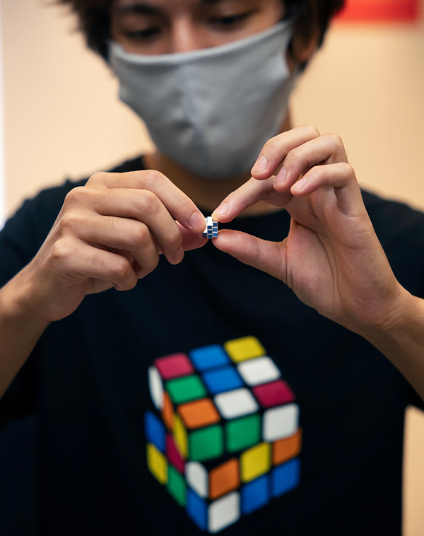 In this photo provided by Maciej Komorowski of Hungary Embassy, the world's smallest Rubik's Cube is shown in Tokyo Wednesday, Sept. 23, 2020, to commemorate the 40th anniversary of the six-sided puzzle in Japan. Photo: Maciej Komorowski of Hungary Embassy via AP