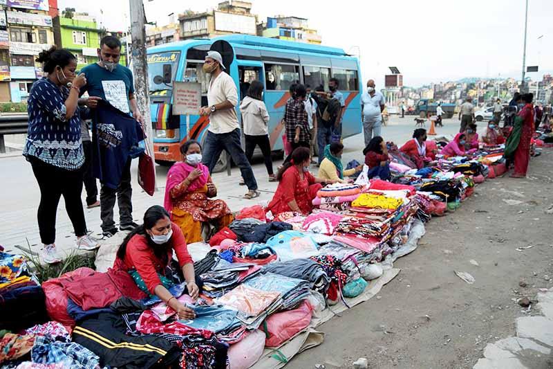 Vendors selling clothes by the roadside in Kalanki, Kathmandu Metropolitan City, on Tuesday, September 22, 2020. Photo: Balkrishna Thapa Chhetri/THT