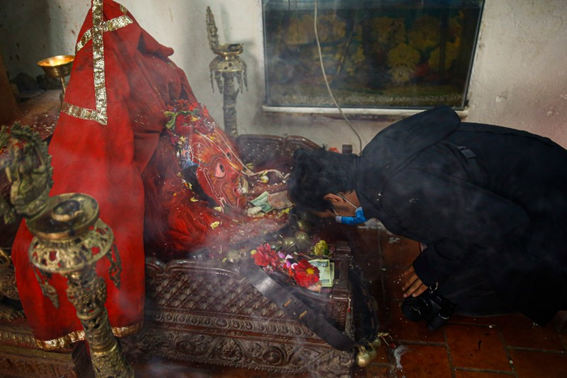 Here, a devotee is seen paying his respect to the mask of Majipa Lakhey, seated on its throne who, as per Newari folklore, is said to be the protector of the children. Photo: Skanda Gautam/THT
