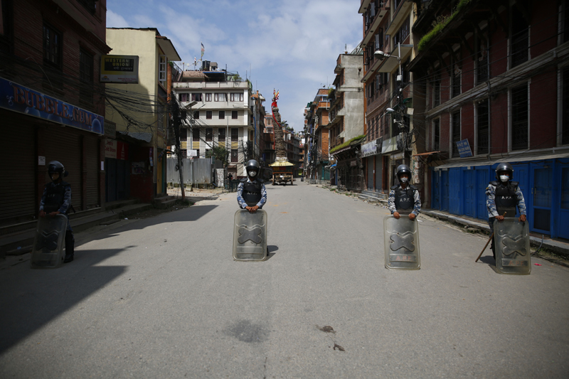 Security personnel patrol the areas during a curfew imposed by the administration in Lalitpur district. Photo: Skanda Gautam