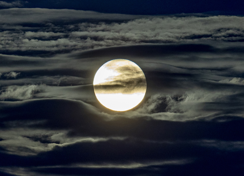 In this Sept. 2, 2020 file photo, the full moon shines surrounded by clouds in the outskirts of Frankfurt, Germany. Photo: AP/File