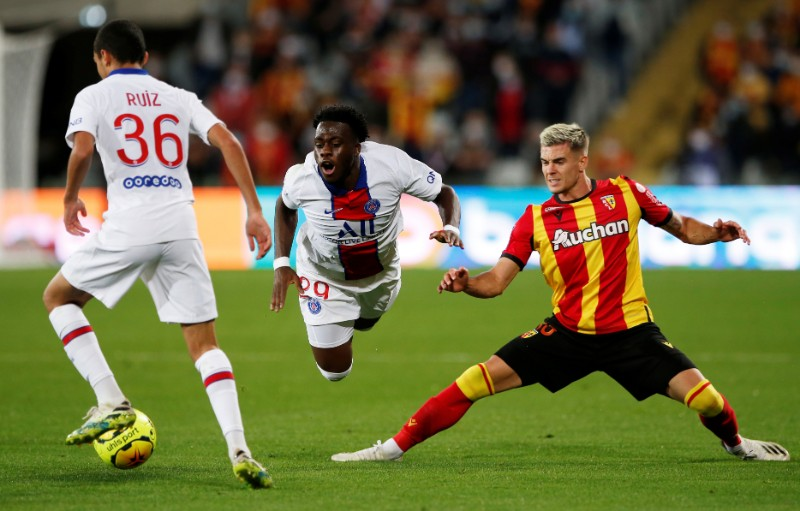 Paris St Germain's Arnaud Kalimuendo-Muinga in action with RC Lens' Clement Michelin during their Ligue 1 match at Stade Bollaert-Delelis, in Lens, France , on September 10, 2020. Photo: Reuters