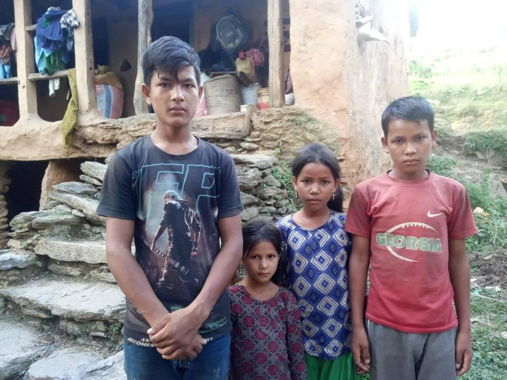 Four siblings - Lokendra, Tek, Samjhana and Bipana - left in destitute after their father's death and mother's abandonment pose for a picture infront of their house in Borawada of Budhhiganga Municipality-6 of Bajura, on Monday, September 28, 2020. Photo: Prakash Singh/ THT