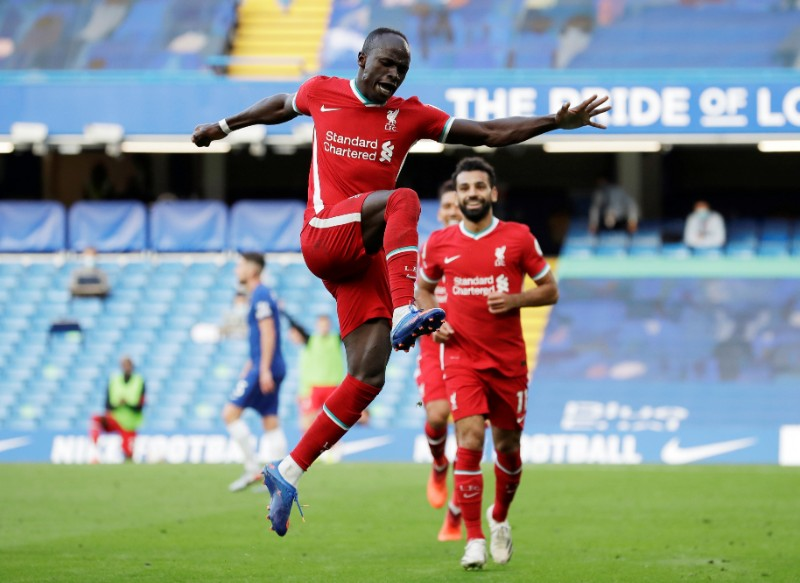 Liverpool's Sadio Mane celebrates scoring their second goal with Mohamed Salah during their Premier League  match between Chelsea and  Liverpool, at Stamford Bridge, in London, Britain, on September 20, 2020.  Photo: Pool via Reuters