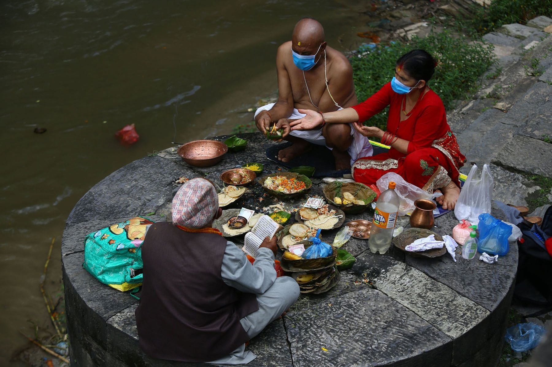 People observing Sorha Shraddha on the banks of the Bagmati River, in Kathmandu, on Wednesday.  Photo: RSS
