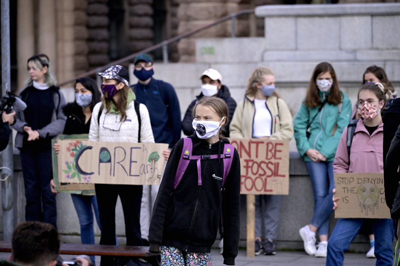 Swedish climate activist Greta Thunberg and others protest in front of the Swedish Parliament Riksdagen in Stockholm Friday, Sept. 25, 2020. Photo:  Janerik Henriksson/TT News Agency via AP
