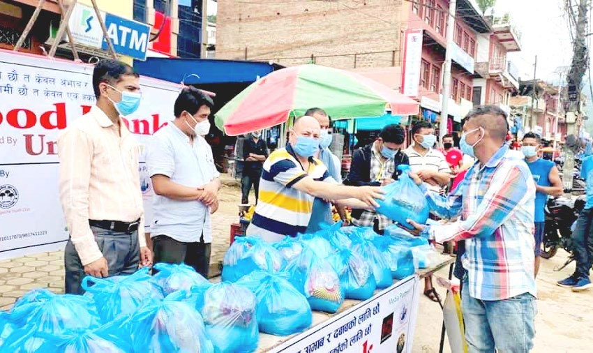 Food materials being distributed to people from the food banku00a0establishedu00a0atu00a0Dumre, inu00a0Tanahun, on Wednesday. Photo: THTu00a0
