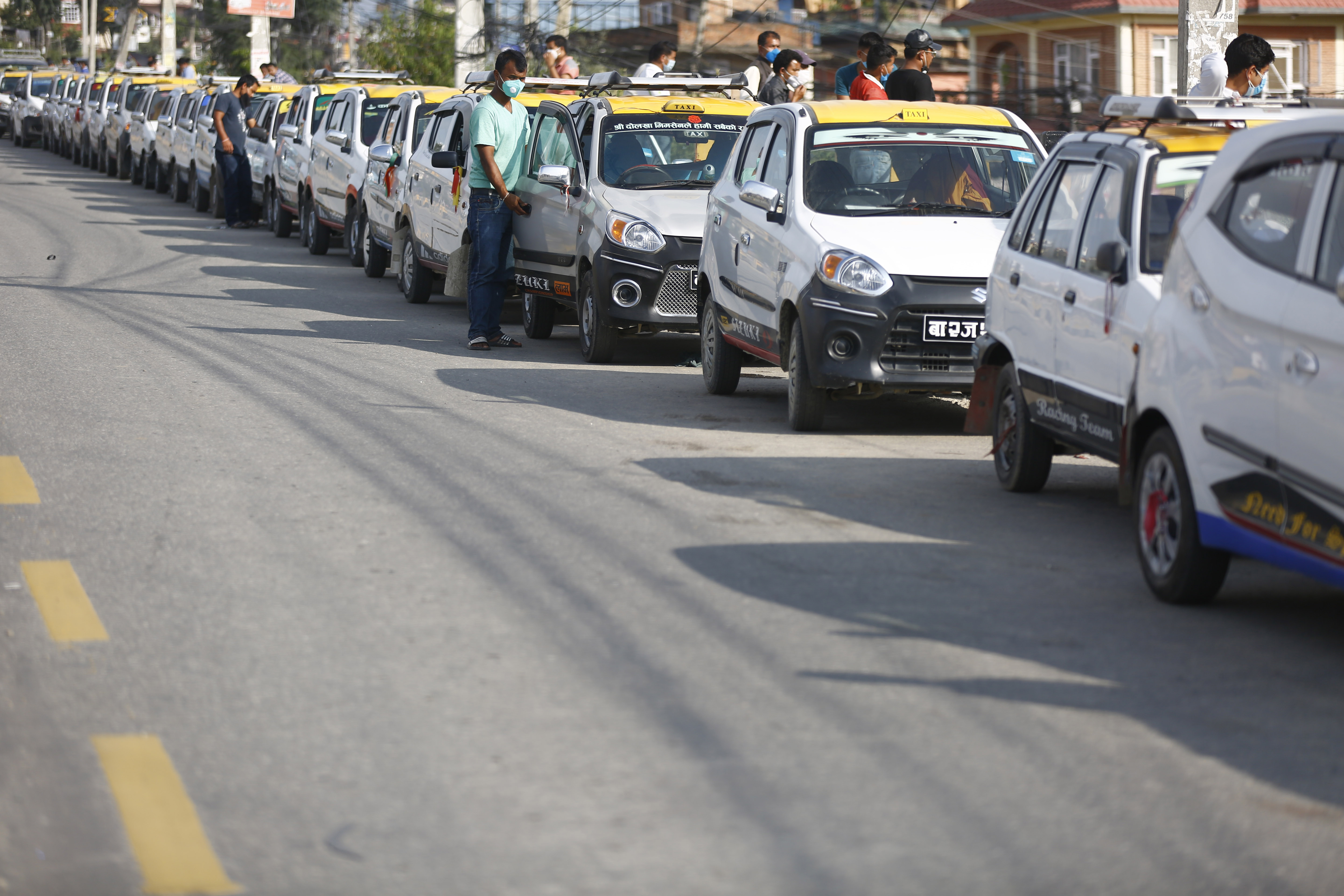 A long queue of cabs to pay taxes and conduct pollution tests after the office was closed due to the COVID-19 pandemic lockdown at Ekantakuna in Lalitpur on Tuesday. Photo/Skanda Gautam/THT