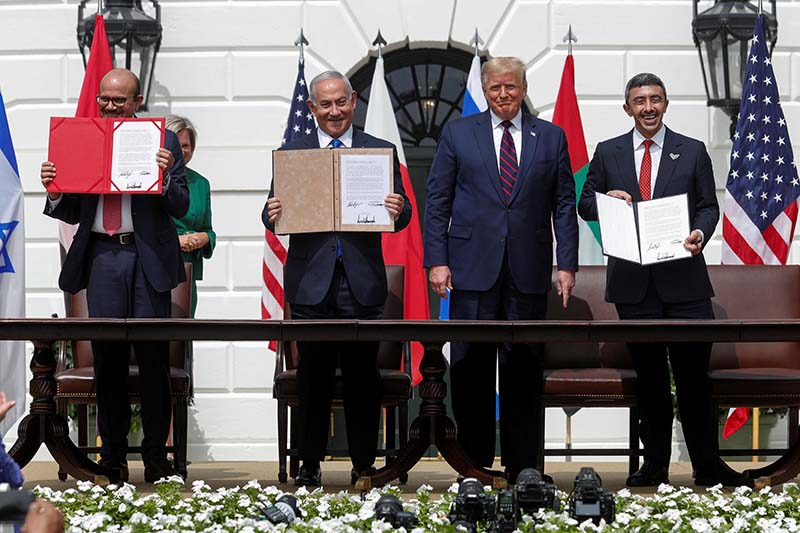 Bahrainu2019s Foreign Minister Abdullatif Al Zayani, Israel's Prime Minister Benjamin Netanyahu and United Arab Emirates (UAE) Foreign Minister Abdullah bin Zayed display their copies of signed agreements while US President Donald Trump looks on as they participate in the signing ceremony of the Abraham Accords, normalising relations between Israel and some of its Middle East neighbors, in a strategic realignment of Middle Eastern countries against Iran, on the South Lawn of the White House in Washington, US, on September 15, 2020. Photo: Reuters