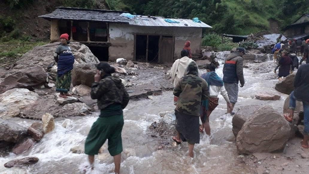 Locals observing the damage caused by the Bhujikhola in Dhorpatan Municipality, Baglung. Photo: THT