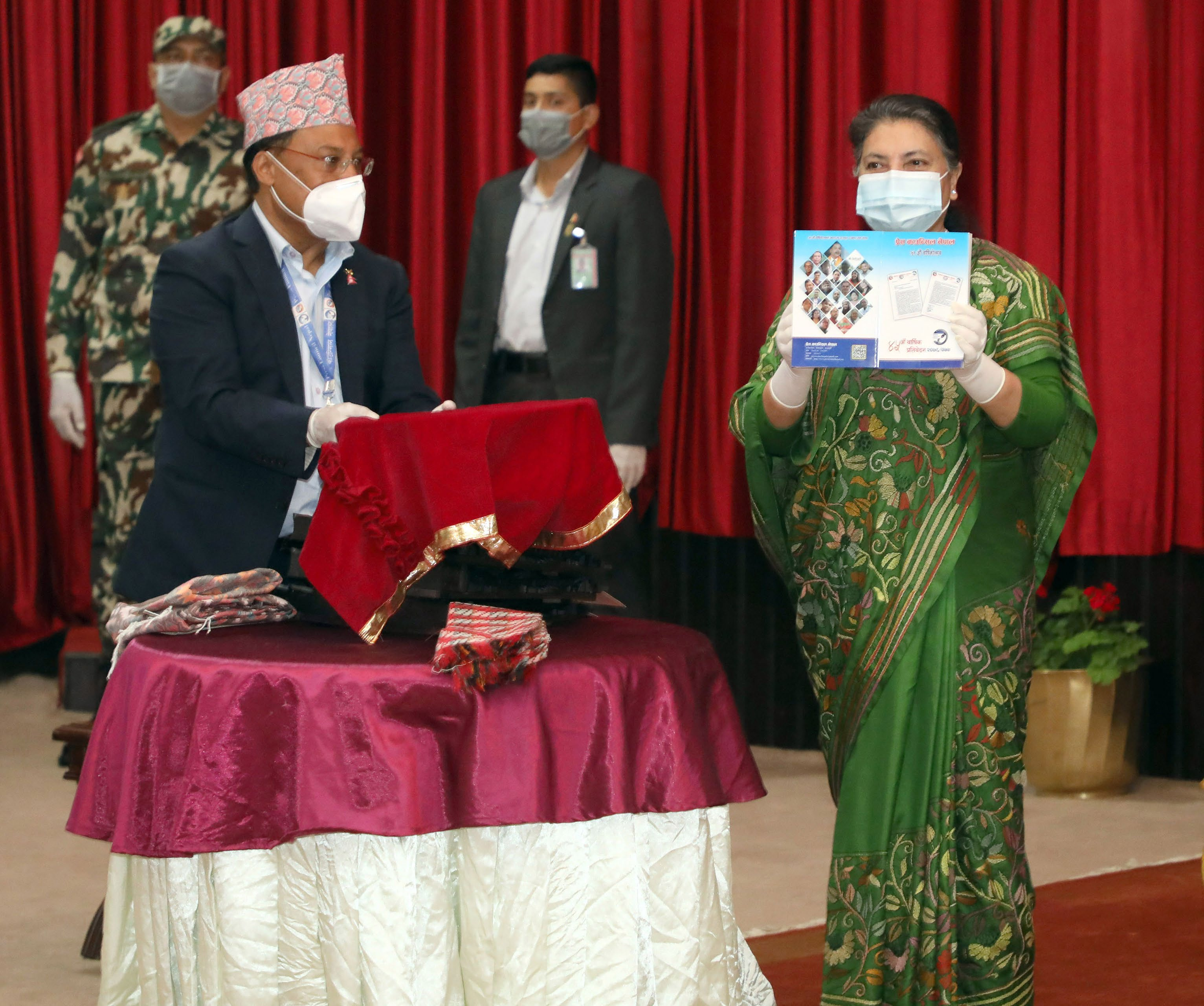 President Bidhya Devi Bhandari releasing annual report of the Nepal Press Council during a programme at Sheetal Niwas, Kathmandu, on Tuesday. Photo: RSS