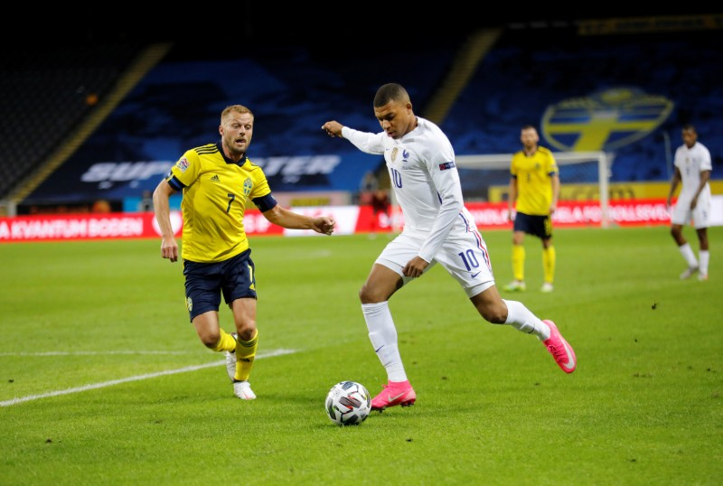 France's Kylian Mbappe and Sweden's Sebastian Larsson during the UEFA Nations League football match between Sweden and France at Friends Arena in Stockholm, Sweden September 05, 2020. Photo: TT News Agency/Christine Olsson via Reuters