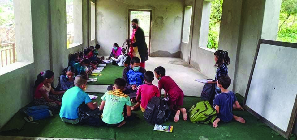 Students of Pasale Primary School attending classes, in Myagde Rural Municipality, Tanahun, on Saturday. Photo: THT
