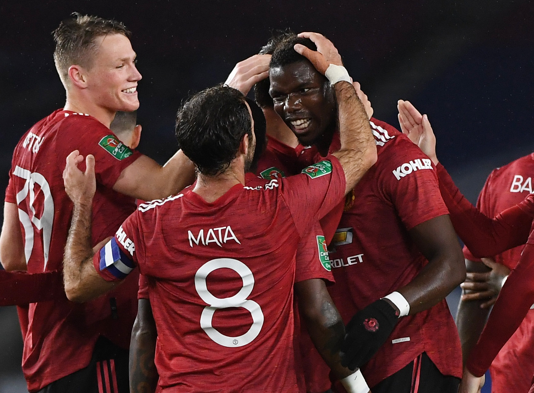 Manchester United's Paul Pogba celebrates scoring their third goal with teammates during the Carabao Cup Fourth Round match between Brighton & Hove Albion and Manchester United , at The American Express Community Stadium, in Brighton, Britain, on  September 30, 2020.  Photo: Pool via Reuters