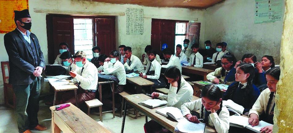 A teacher wearing face mask conducting class in Malika Secondary School, in Martadi, Bajura, on Monday. Photo: THT