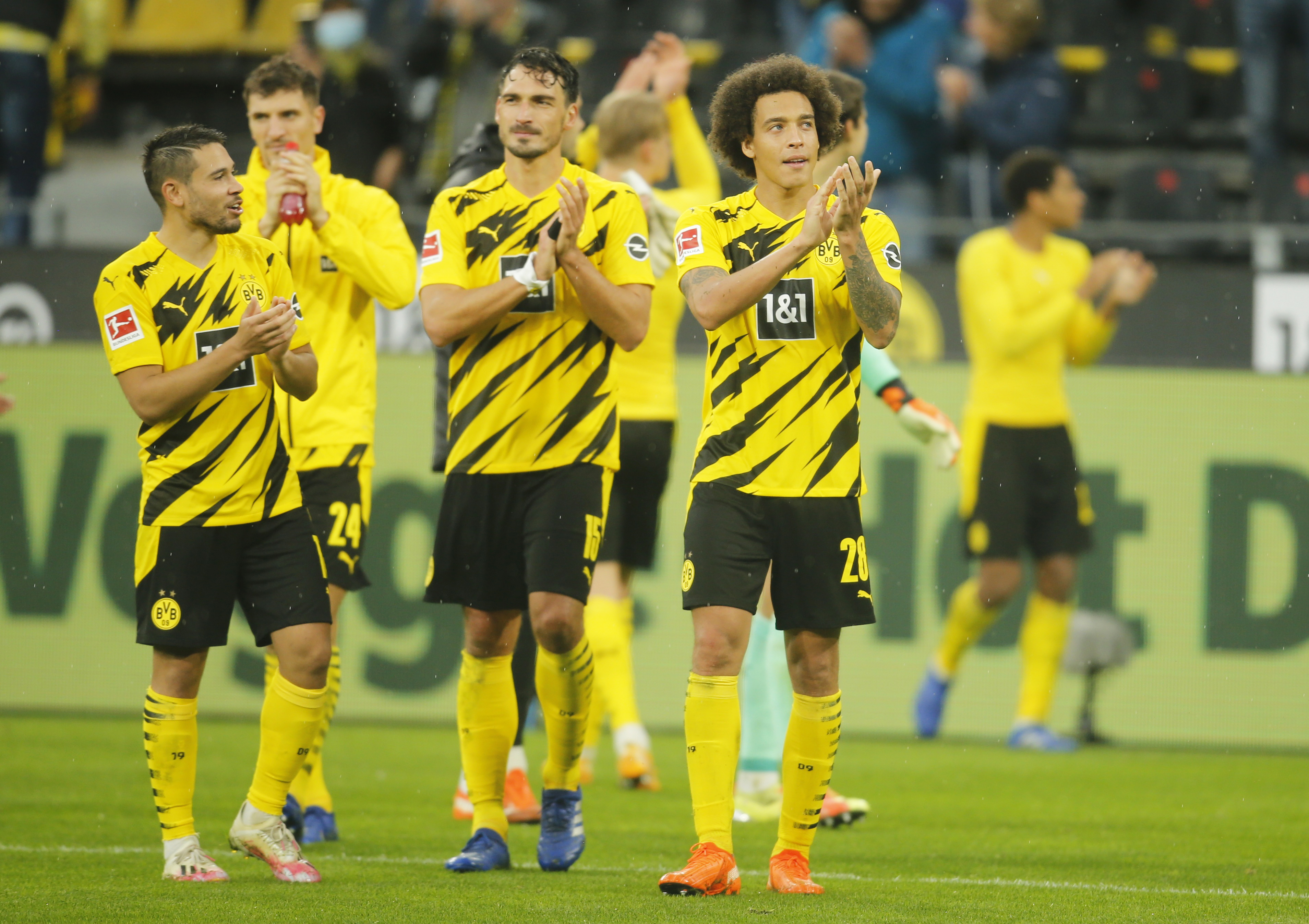 Borussia Dortmund's Mats Hummels and Axel Witsel applaud fans after the match. Photo: Reuters
