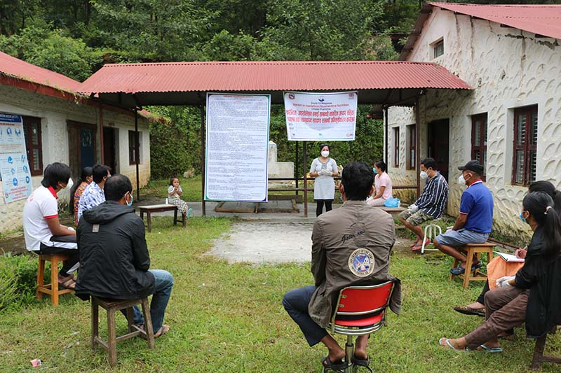 A heath worker holding discussion with quarantined people at a quarantine facility in Dhading district, on Friday, October 2, 2020. Photo: Keshav Adhikari/THT