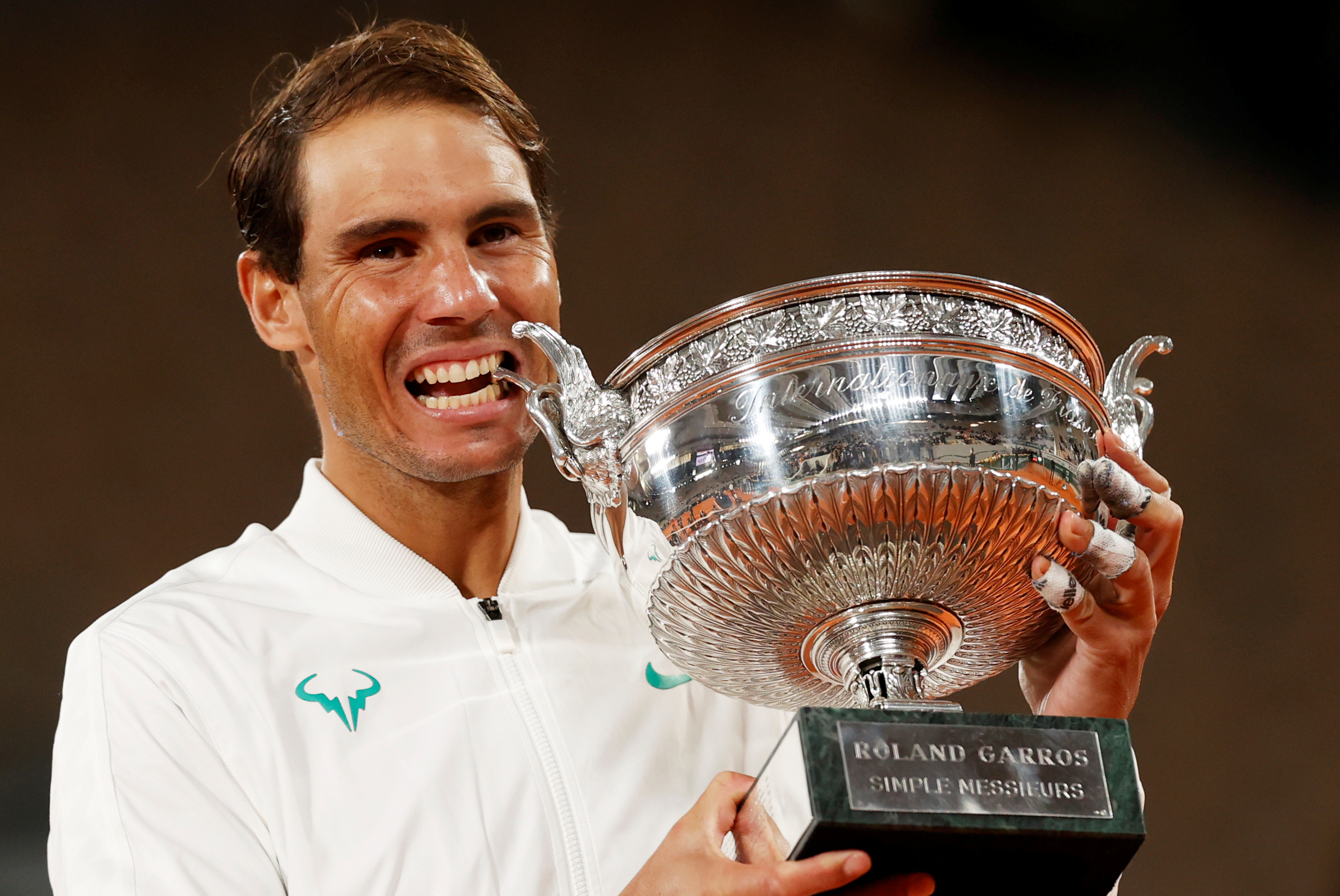 Spainu2019s Rafael Nadal celebrates with the trophy after winning the French Open final against Serbiau2019s Novak Djokovic. Photo: Reuters