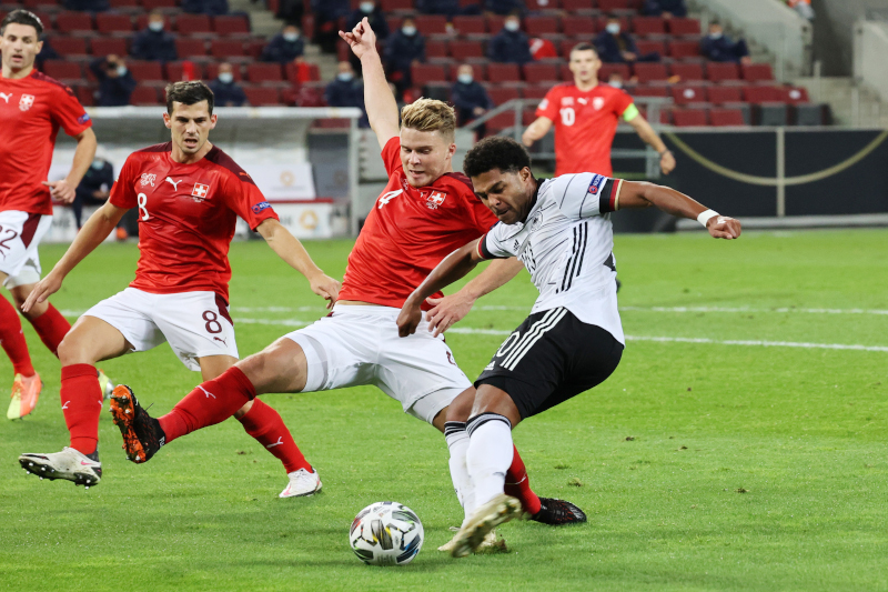 Germany's Serge Gnabry in action with Switzerland's Nico Elvedi during their UEFA Nations League, League A, Group 4 match at Rhein Energie Stadion, in Cologne, Germany, on October 13, 2020. Photo: Reuters