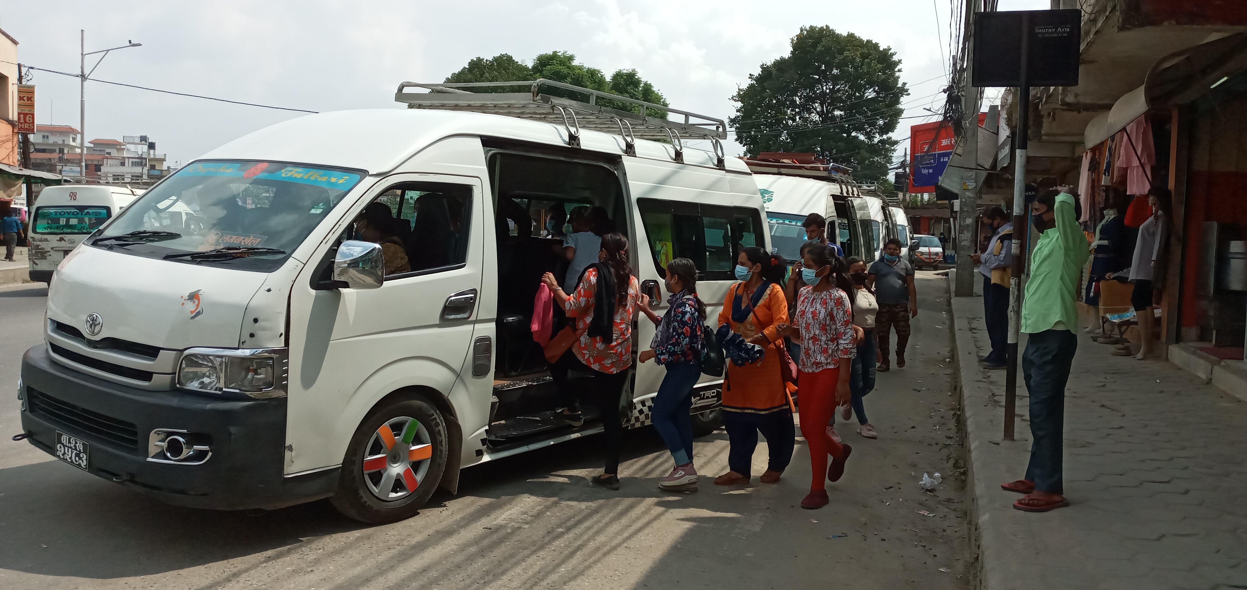 Daily commuters board a microbus in Lagankhel, Lalitpur, on Thursday. Photo: BalKrishna Thapa/THT