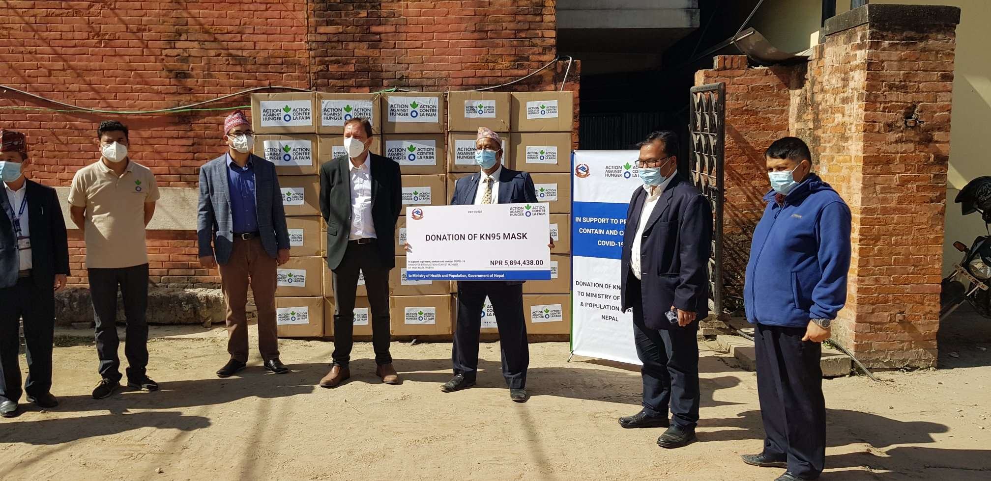 Representatives from Action Against Hunger Nepal pose for a portrait after handing over KN95 masks to the Ministry of Health and Population, in Kathmandu, on Monday, November 09, 2020. Photo Courtesy: Action Against Hunger Nepal