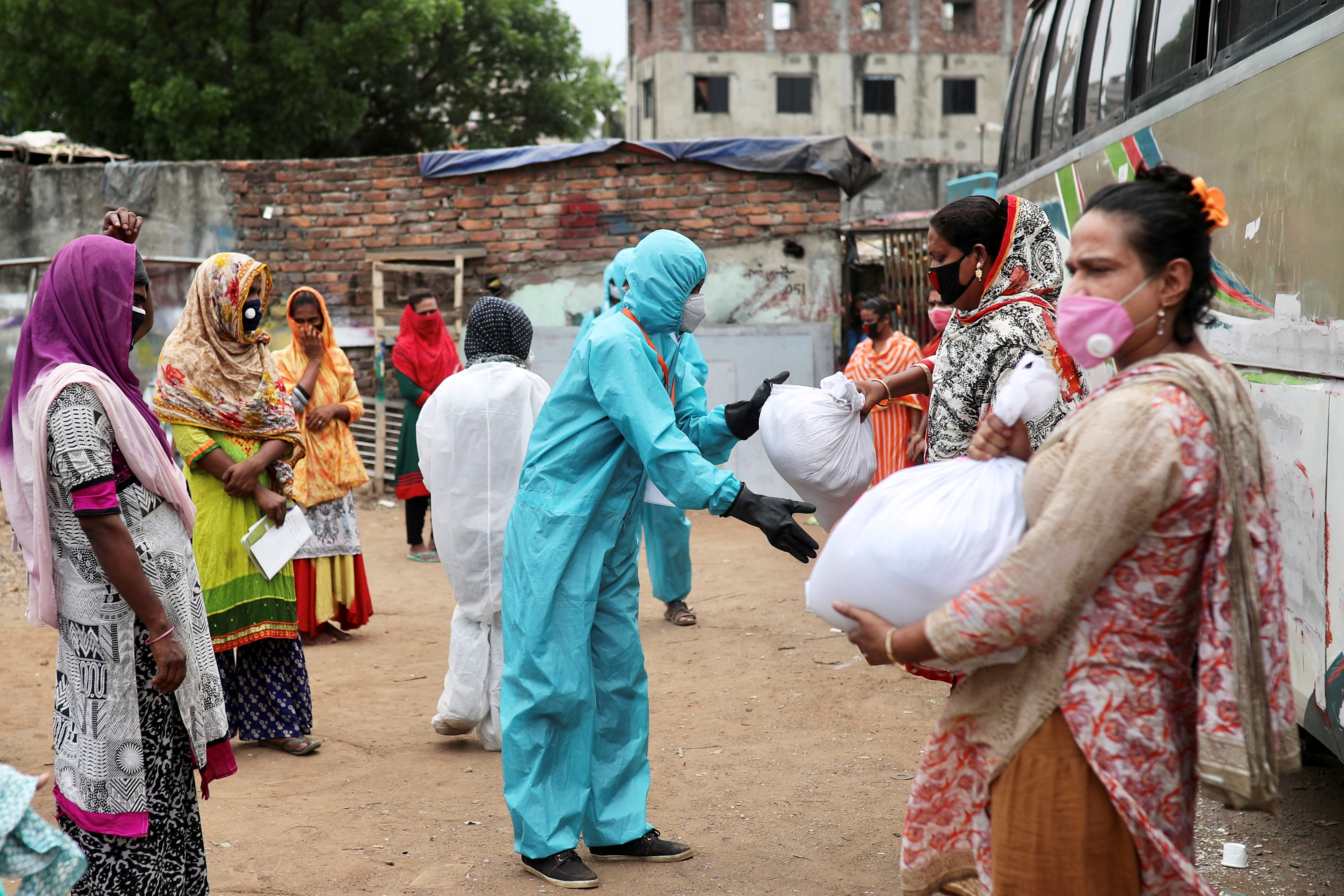 FILE PHOTO: Volunteers from an organisation distribute relief supplies among transgenders, amid the coronavirus disease (COVID-19), in Dhaka, Bangladesh, April 23, 2020. REUTERS/Mohammad Ponir Hossain/File Photo