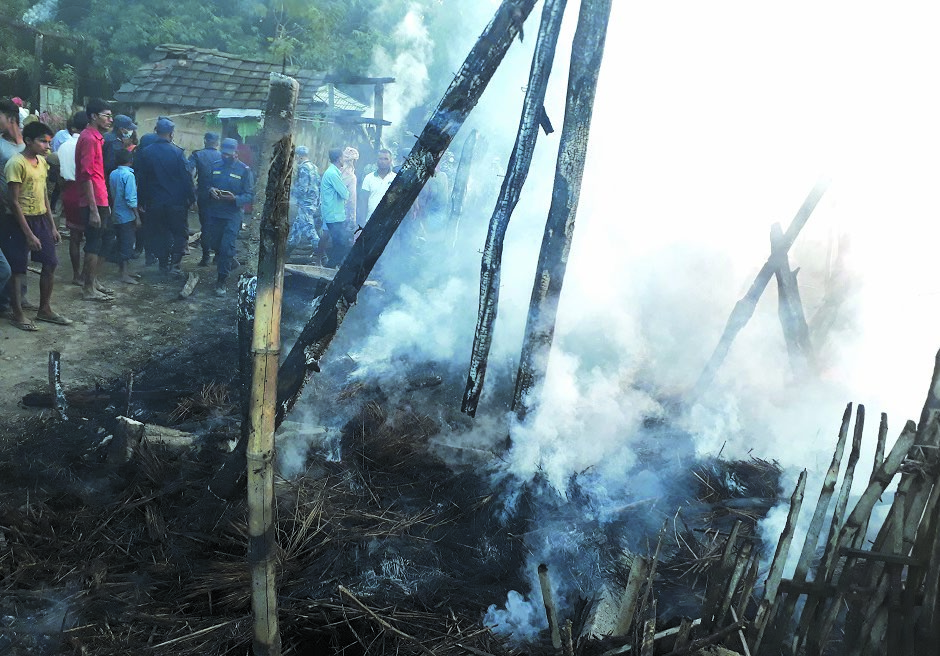 Security personnel and locals putting out the blaze in Sakhui of Kalaiya Sub-metropolitan City, Bara, on Monday. Photo: THT