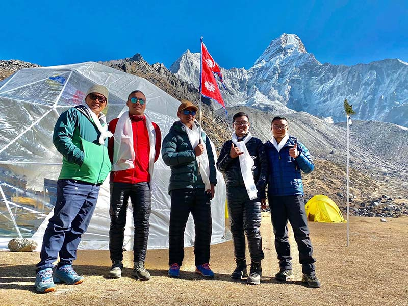 This undated image shows the Seven Summit Treks Ama Dablam expedition autumn team members posing for a photograph. Photo: SST