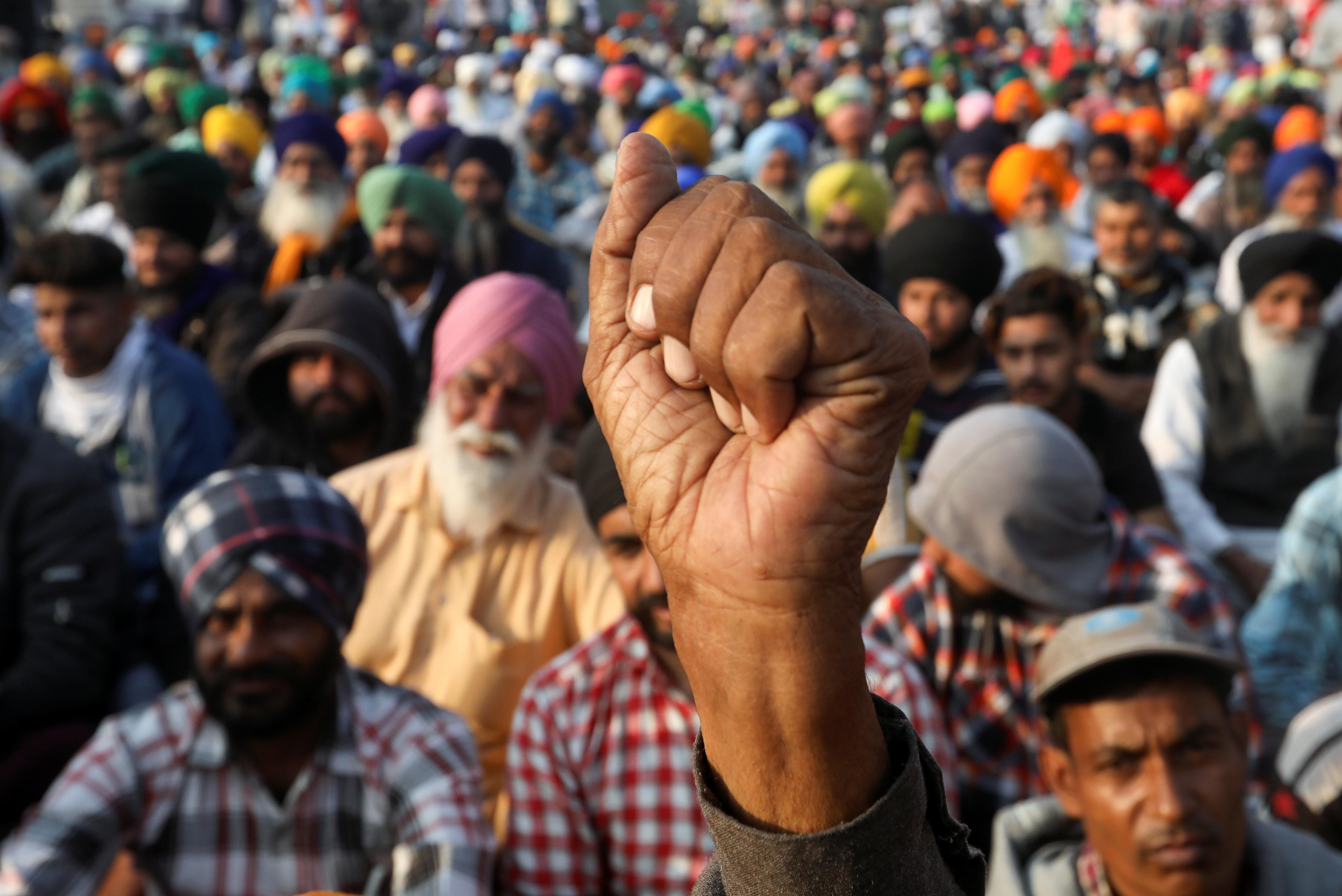 A demonstrator gestures during a protest against the newly passed farm bills at Singhu border near New Delhi, India, December 10, 2020. Photo: Reuters