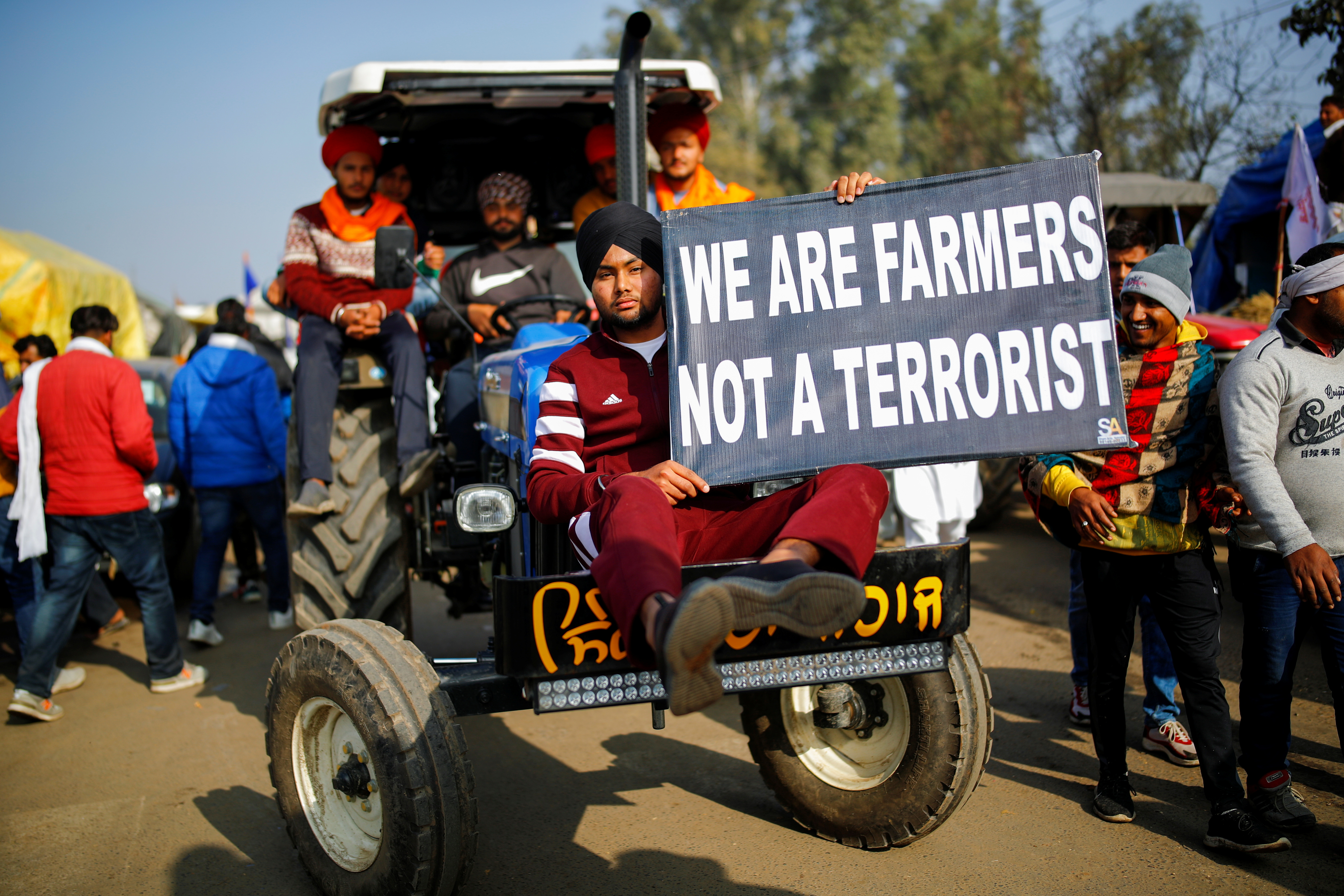 Farmers arrive in a tractor to attend a protest against the newly passed farm bills at Singhu border near New Delhi, India, December 14, 2020. Photo: Reuters