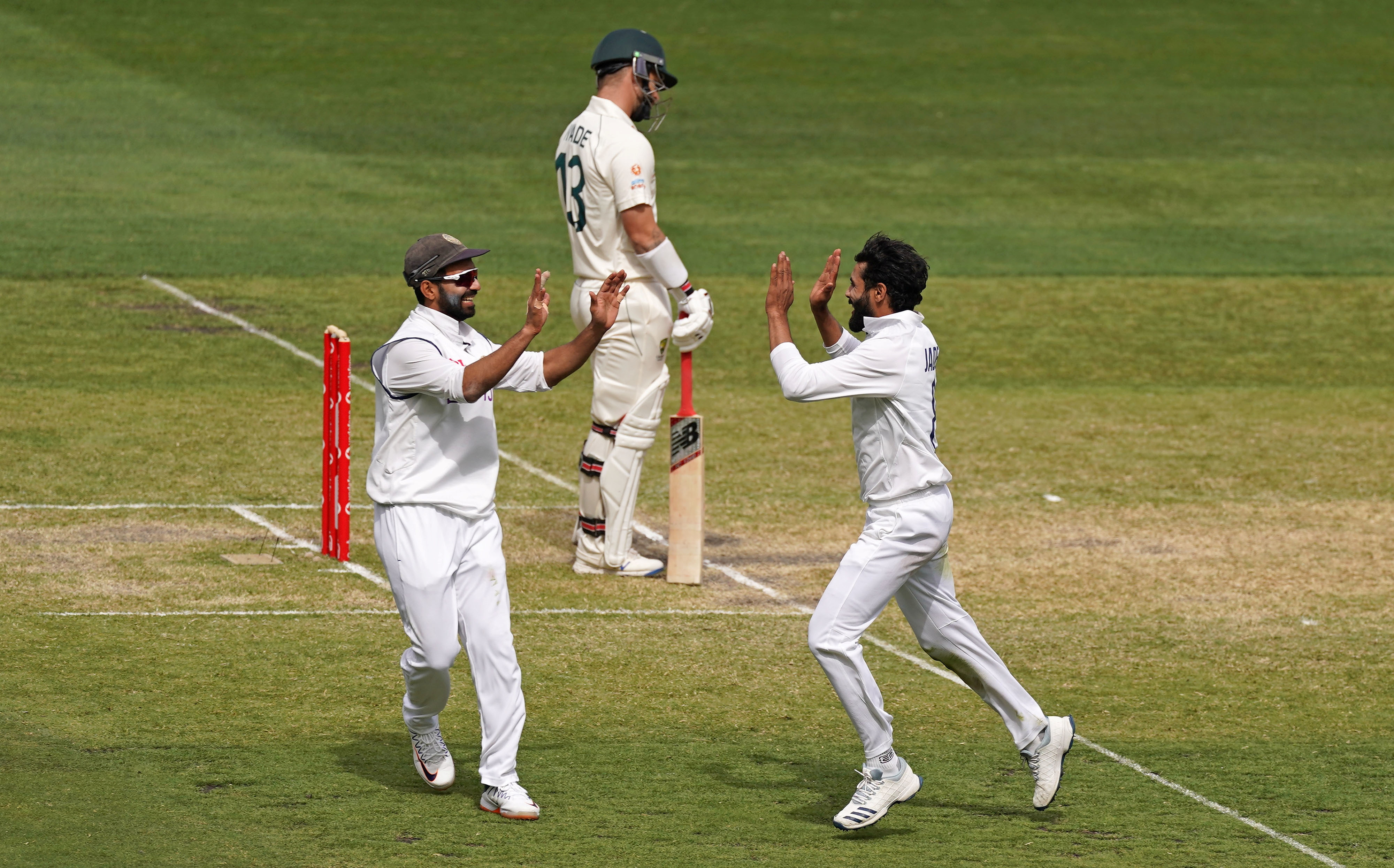 India's Ravindra Jadeja celebrates after taking the wicket from Matthew Wade of Australia with Ajinkya Rahane during day three of the second test match between Australia and India at The MCG, Melbourne, Australia, December 28, 2020. Photo: Reuters