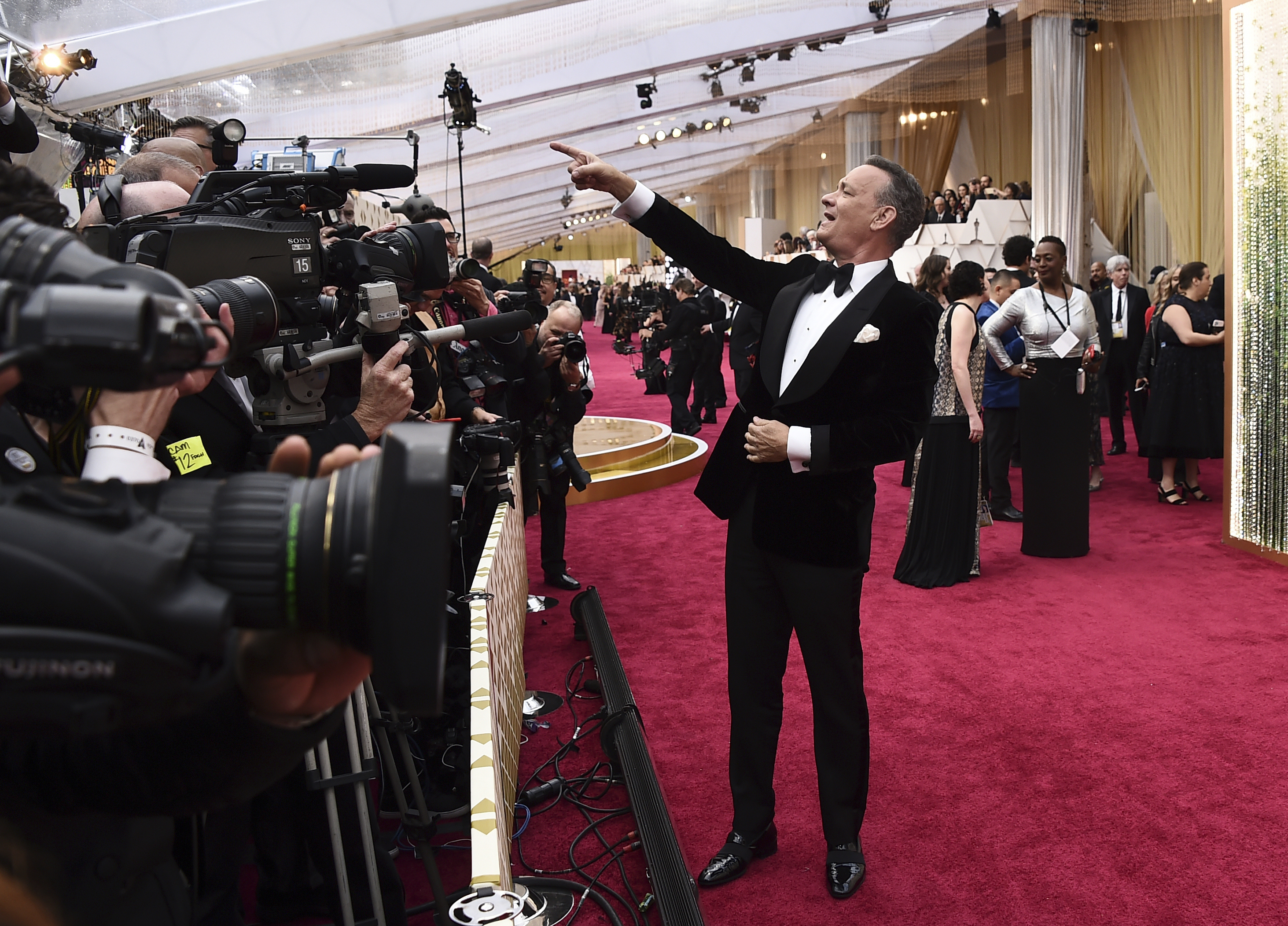 FILE - Tom Hanks arrives at the Oscars in Los Angeles on Feb. 9, 2020. Hollywoodu2019s awards season has gone virtual. This time of year would normally be flush with splashy premieres, cocktail parties and star-studded screening. This year, Oscar campaigns are having to make do with virtual Q&As and home-delivered gift baskets. Photo: AP