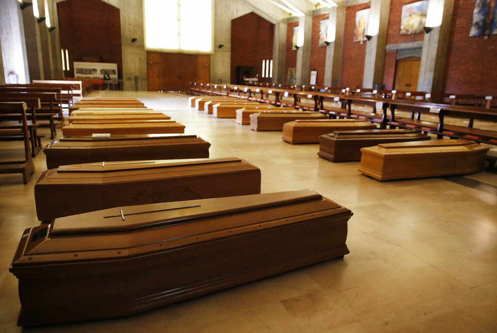 In this March 26, 2020 file photo, coffins are lined up on the floor in the San Giuseppe church in Seriate, one of the areas worst hit by coronavirus, near Bergamo, Italy, waiting to be taken to a crematorium. Italy is poised to reclaim the dishonor of reporting the most coronavirus deaths in Europe, as the second surge ravages the countryu2019s disproportionately old population and exposes how public health shortfalls and delayed restrictions compounded a lack of preparedness going into the pandemic. Photo: AP