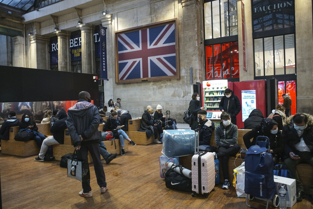 Passengers wearing face mask wait next to the Eurostar Terminal at Gare du Nord train station in Paris, Monday December 21, 2020. France is banning all travel from the UK for 48 hours in an attempt to make sure that a new strain of the coronavirus in Britain doesn't reach its shores. Photo: AP