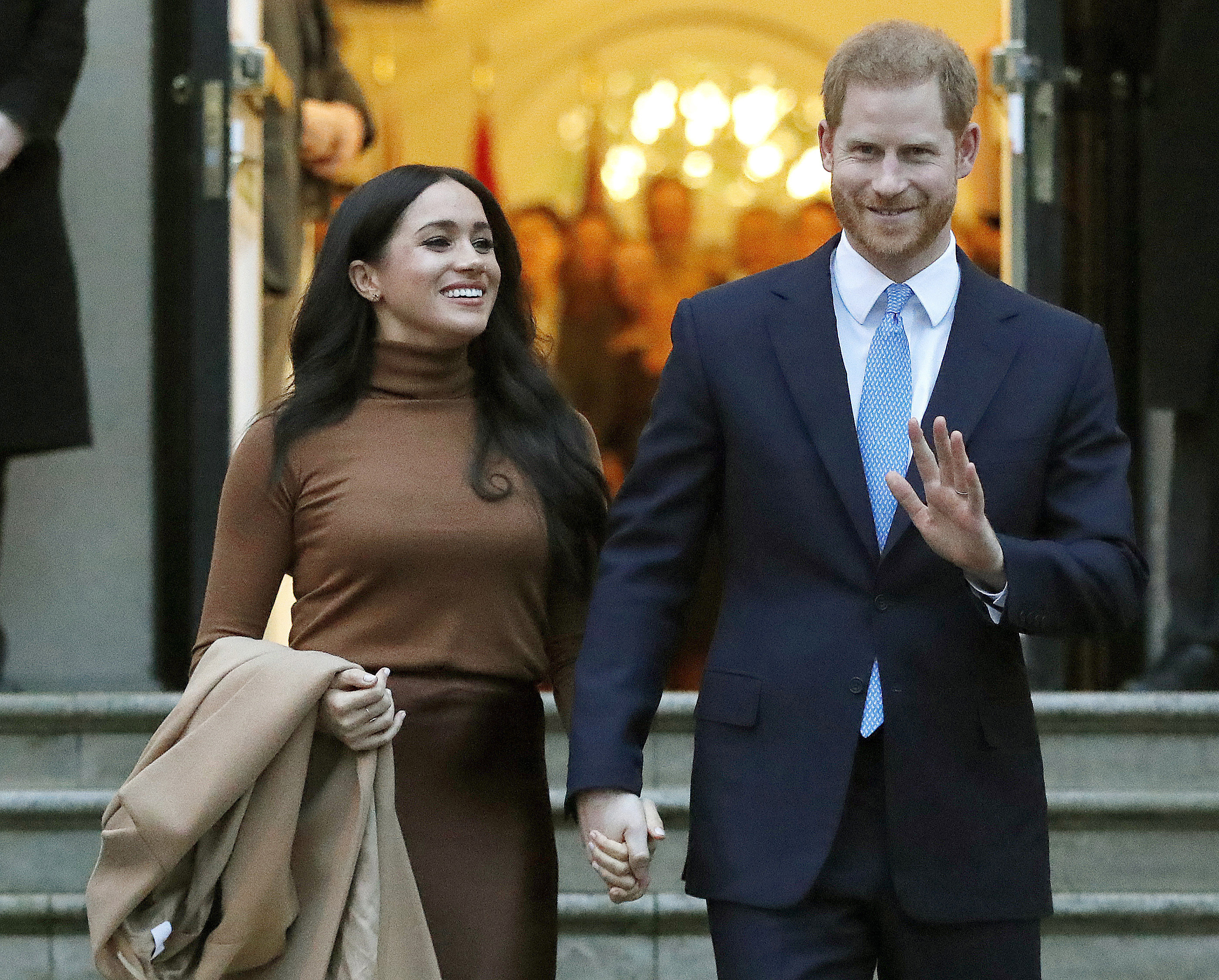 FILE - Prince Harry and Meghan, the Duke and Duchess of Sussex, leave after visiting Canada House on Jan. 7, 2020, in London. The royal couple and guests from Elton John to their son Archie appear on their new podcast's first audio release on Tuesday, Dec. 29, 2020, for Spotify, a 34-minute special with reflections on 2020.  Photo: AP