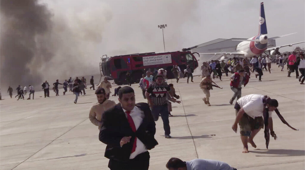 People run after an explosion at the airport in Aden, Yemen, shortly after a plane carrying the newly formed Cabinet landed on Wednesday, December 30, 2020. No one on board the government plane was hurt but initial reports said several people at the airport were killed.   Photo: AP