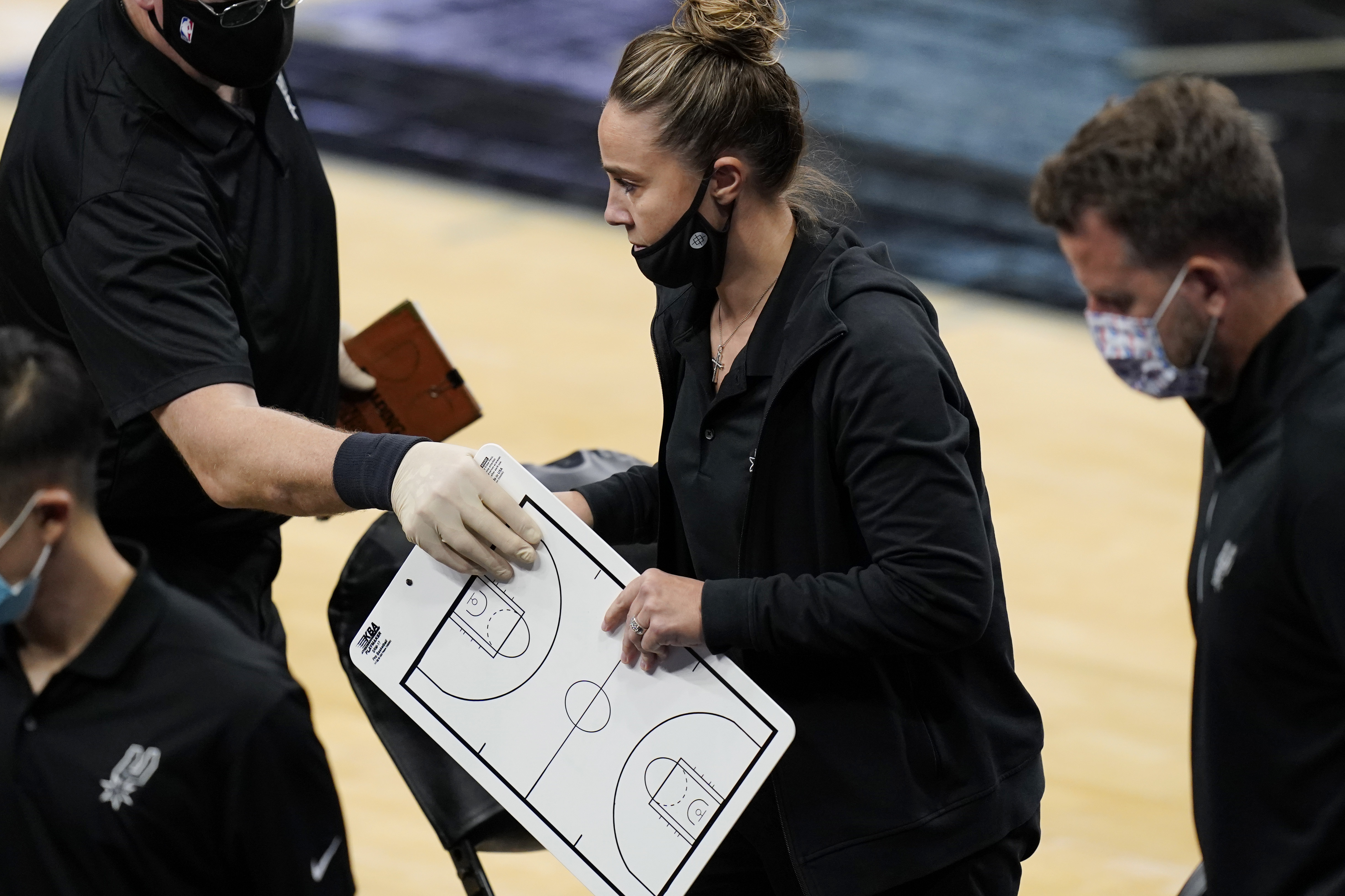 San Antonio Spurs assistant coach Becky Hammon breaks from a huddle during a timeout in the second half of an NBA basketball game against the Los Angeles Lakers in San Antonio, Wednesday, Dec. 30, 2020. Hammon became the first woman to direct an NBA team, taking over the Spurs after coach Gregg Popovich was ejected in a 121-107 loss to the Lakers. Photo: AP