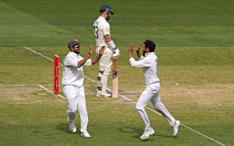 India's Ravindra Jadeja celebrates after taking the wicket from Matthew Wade of Australia with Ajinkya Rahane during day three of the second test match between Australia and India at The MCG, Melbourne, Australia, December 28, 2020. Photo: AAP Image/Scott Barbour via Reuters