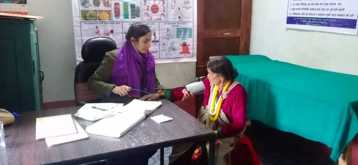 Ayurvedic health worker providing services in District Ayurvedic Health Centre, Bajura, on Tuesday, December 8, 2020. Photo: Prakash Singh/ THT